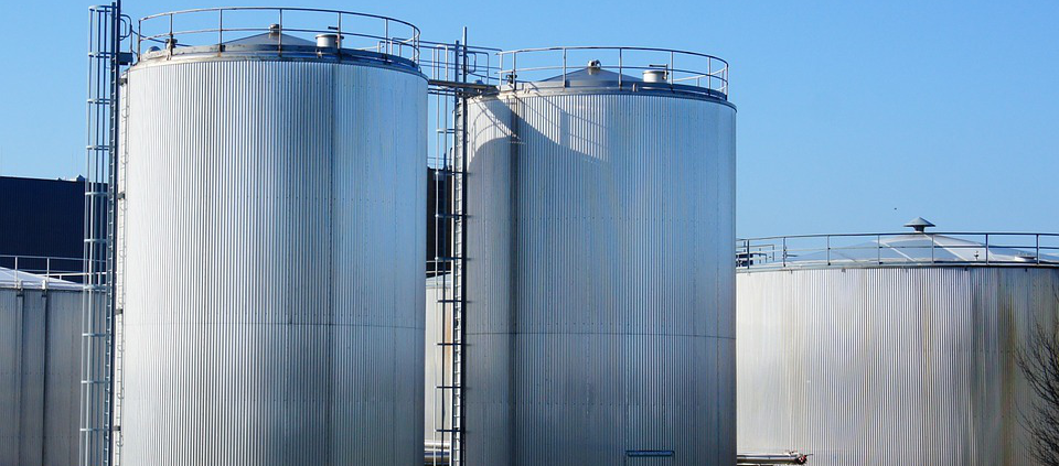 Storage tanks outside a factory.