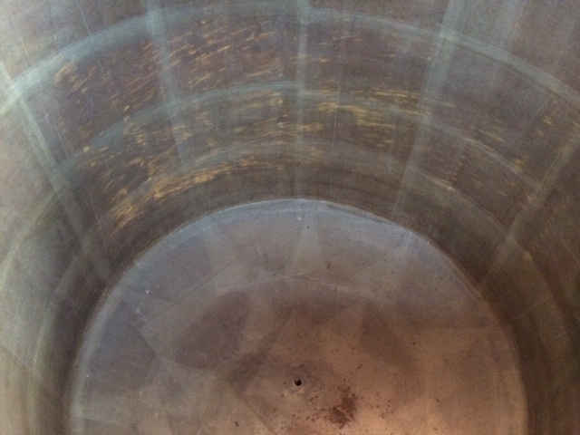 The internal side of a large fiberglass storage tank