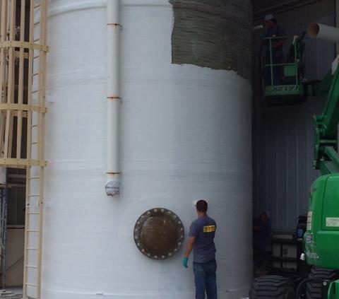 FRP tank under repair.